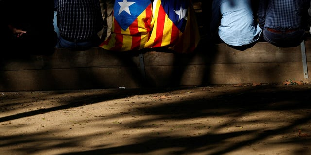 People display Catalan separatist flags during a demonstration outside the Catalan regional parliament in Barcelona.