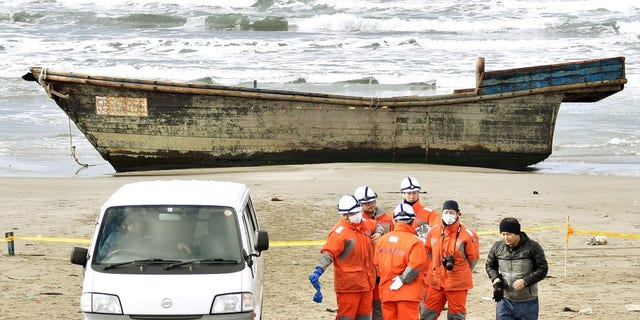 The wooden boat filled with skeletal remains was discovered by a Japanese resident on Friday.