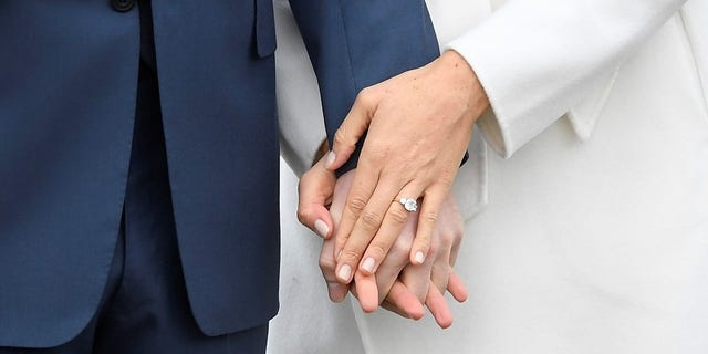 Meghan Markle's ring was designed by Harry and includes two diamonds from Princess Diana's jewelry collection.