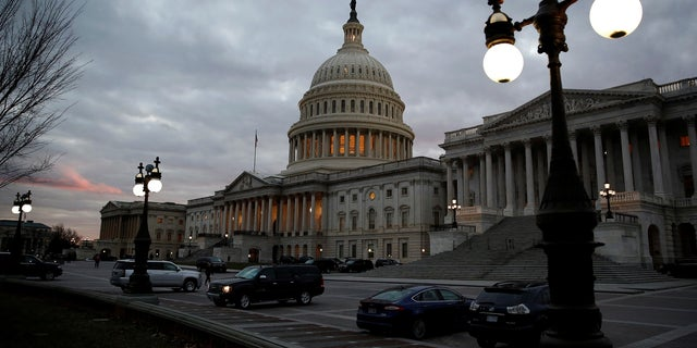 The U.S. Capitol building is lit at dusk in Washington, U.S., December 18, 2017.