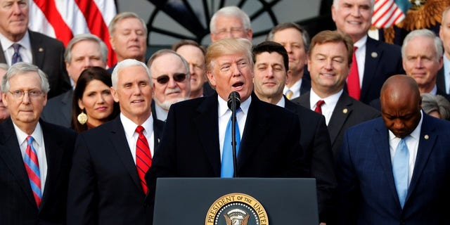 President Trump celebrated with Republican lawmakers after the House passed the tax bill.
