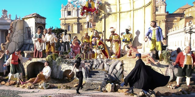 The topless activist was seen charging toward the nativity scene in Vatican City on Christmas.