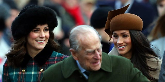 Kate Middleton and Meghan Markle talk while arriving for the Christmas service.
