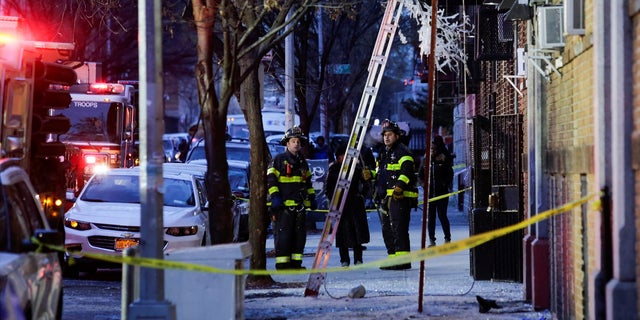 Fire Department of New York personnel at the scene of the devastating apartment fire in the Bronx.