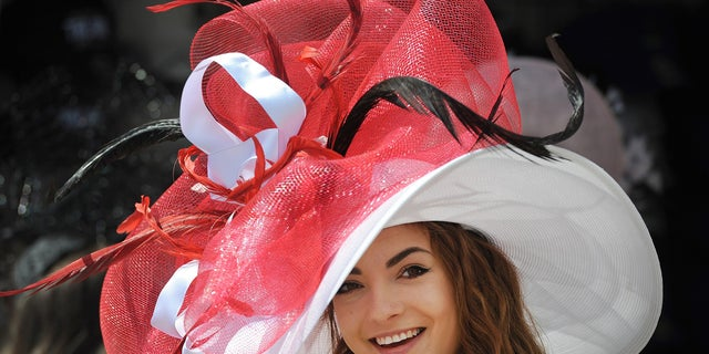 Monique Rosteing poses with her derby hat before the 142nd running of the Kentucky Derby at Churchill Downs.