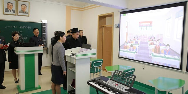 Kim Jong Un at looking at an image in one of the classrooms.