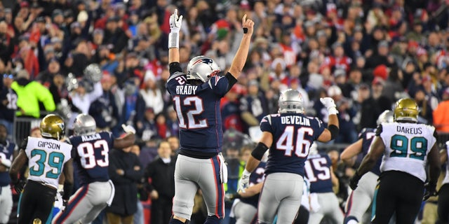 New England Patriots quarterback Tom Brady (12) celebrates during the AFC Championship game.