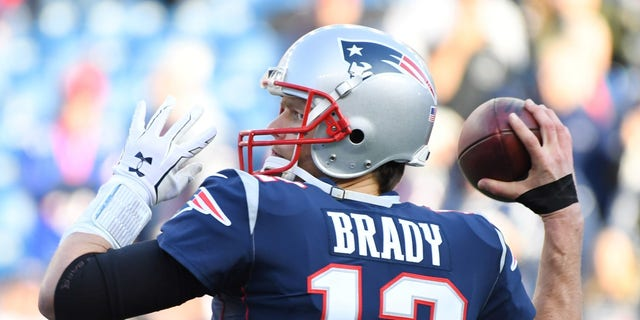 Jan 21, 2018; Foxborough, MA, USA; New England Patriots quarterback Tom Brady (12) warms up before the AFC Championship Game against the Jacksonville Jaguars at Gillette Stadium.