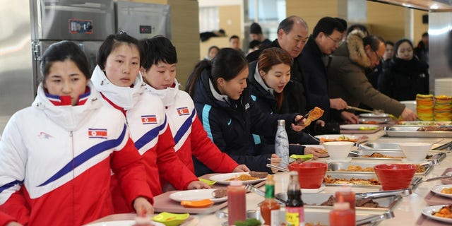 North and South Korea hockey players joined together on Thursday.