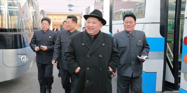 North Korean leader Kim Jong Un inspects a newly established Pyongyang trackless trolley factory.