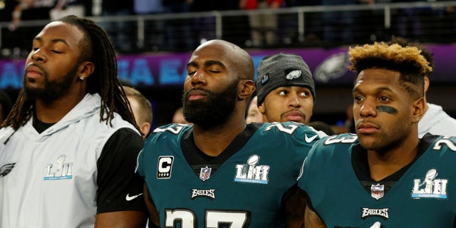 Philadelphia Eagles safety Malcolm Jenkins (27) stands with his teammates during the playing of the national anthem before Super Bowl LBII.