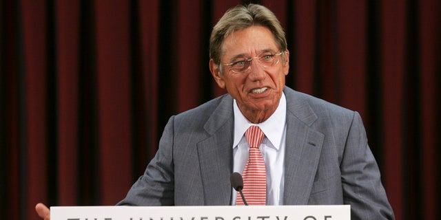 Former NFL quarterback Joe Namath talks with reporters at the University of Alabama in Tuscaloosa, Alabama. Namath, who led the New York Giants to their only Super Bowl win and was named the game's MVP in 1969, graduated from the university in 2007.