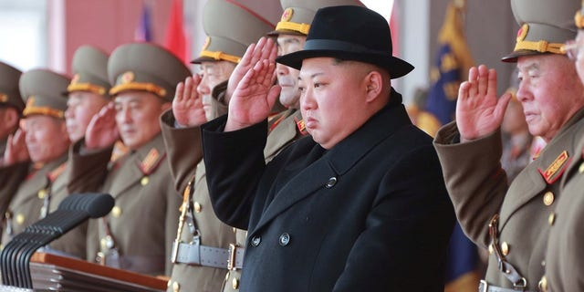 Kim Jong Un watches the military parade held on the eve of Winter Olympics opening ceremony.