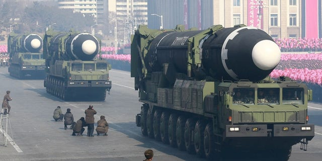 North Korea shows off its missiles in a parade.