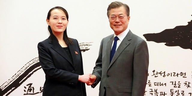 South Korean President Moon Jae-in, right, talks with Kim Yo Jong, the sister of North Korean leader Kim Jong Un.