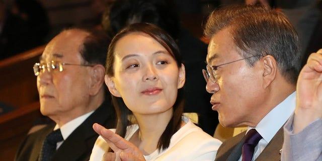 South Korean President Moon Jae-in, right, talks with Kim Yo Jong while watching North Korea's Samjiyon Orchestra.