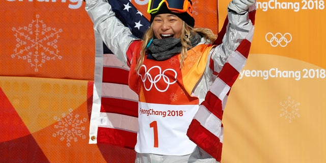 Chloe Kim of the U.S. celebrates after she became the youngest woman to win an Olympic snowboarding gold medal.