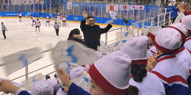 A Kim Jong Un impersonator danced and cheered with the North Korean cheer squad on Wednesday.