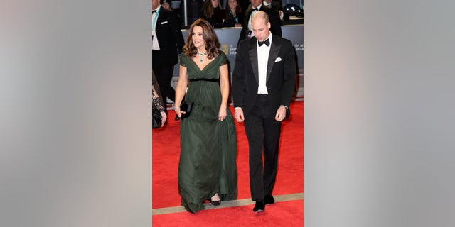 Kate Middleton accessorized her red carpet look on Sunday with a black clutch and heels.