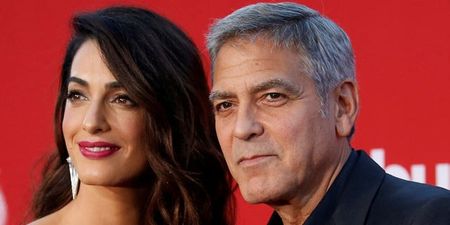 George Clooney, who shares three-year-old twins Alexander and Ella with wife Amal Clooney, left, simply wants his children to 'live in a better world,' George Floyd family attorney Benjamin Crump told 'The View' on Thursday.