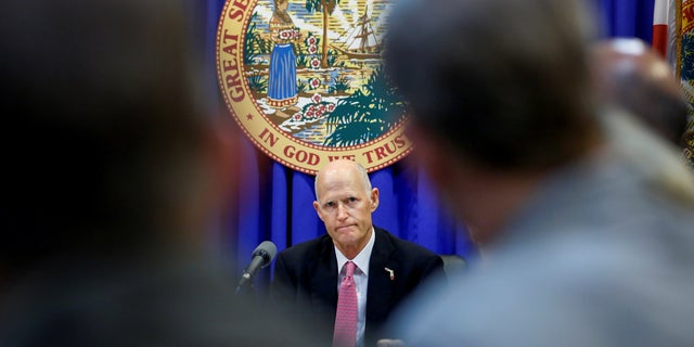 Florida Gov. Rick Scott listens during a meeting with law enforcement, mental health, and education officials about how to prevent future tragedies in the wake of the deadly school shooting earlier this month.
