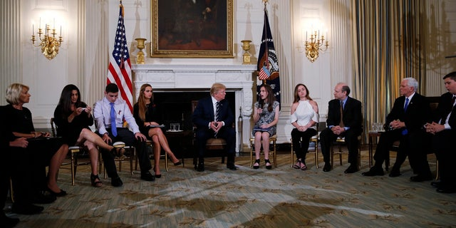 President Trump hosted teachers and students who have been victims of school shootings, along with their parents, at the White House for a listening session in February 2018.