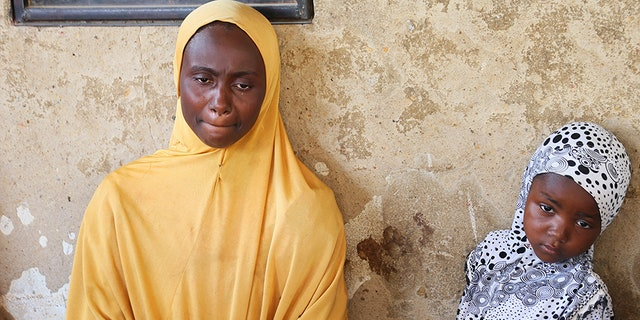 A relative of one of the missing school girls reacts in Dapchi in the northeastern state of Yobe.