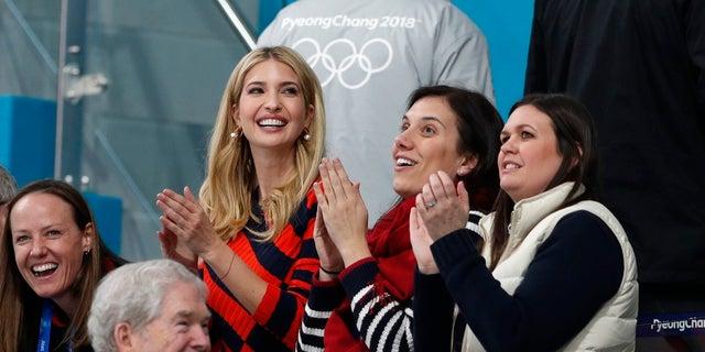 White House press secretary Sarah Sanders, far right, cheers on U.S. Olympic athletes along with Ivanka Trump in South Korea.