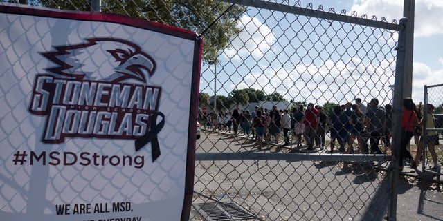 Students and parents arrive for voluntary campus orientation at the Marjory Stoneman Douglas High School, for the coming reopening after the mass shooting on Feb. 14.