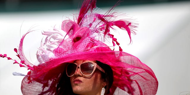 Horse racing fan Ellen Palmer wears a derby hat in the infield during the 142nd running of the Kentucky Derby at Churchill Downs.