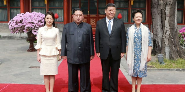 Kim Jong Un, his wife joined Xi Jinping and his wife during a visit in Beijing.