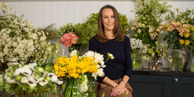 Florist Philippa Craddock, who has been chosen to create the floral displays for the wedding of Prince Harry and Meghan Markle, poses for a photograph in her studio in London.