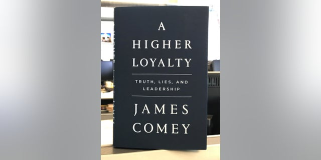 "A copy of former FBI director James Comey's book ""A Higher Loyalty."""