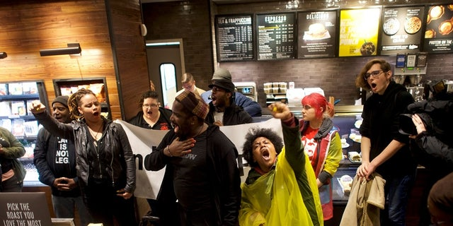 In this photo from April 16, 2018, demonstrators protest at a Starbucks in Philadelphia where two black men were arrested after employees said they were trespassing.