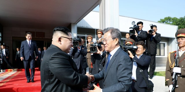 In this May 26, 2018 photo, South Korean President Moon Jae-in meets with North Korean leader Kim Jong Un as he leaves after their summit at the truce village of Panmunjom, North Korea.