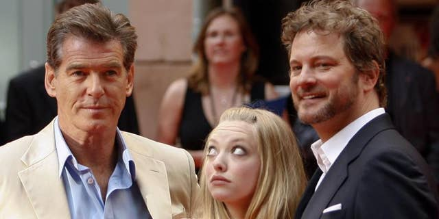 Even actress Amanda Seyfried can't get her eyes off Pierce Brosnan while promoting their film in Stockholm on July 4, 2008.