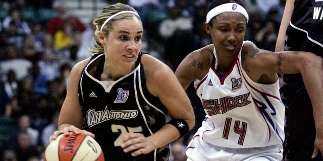 San Antonio Silver Stars guard Becky Hammon drives past Detroit Shock guard Deanna Nolan during the first half of Game 3 of their WNBA basketball finals in Yipsilanti, Mich., Oct. 5, 2008.