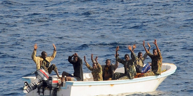 February 11, 2009: Suspected pirates keep their hands in the air as directed by sailors aboard the guided-missile cruiser USS Vella Gulf (CG 72) (not shown), in the Gulf of Aden.