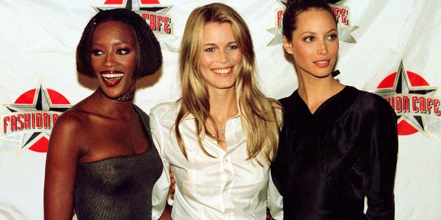 "Supermodels Naomi Cambell (L), Claudia Schiffer (C) and Christy Turlington, pose for photographers as they arrive for the grand opening of their Fashion Cafe in London's West End September 26, 1996. Turlington said the modeling industry is ""surrounded by predators."""