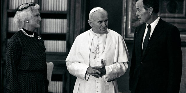 Vice President George Bush and his wife Barbara with Pope John Paul II during an audience at the Vatican, June 24, 1985.