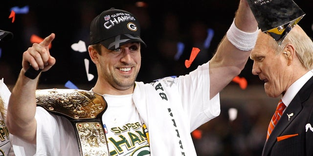 Green Bay Packers MVP quarterback Aaron Rodgers celebrates with the Vince Lombardi trophy after the Packers defeated the Pittsburgh Steelers in the NFL's Super Bowl XLV football game in Arlington, Texas, February 6, 2011.