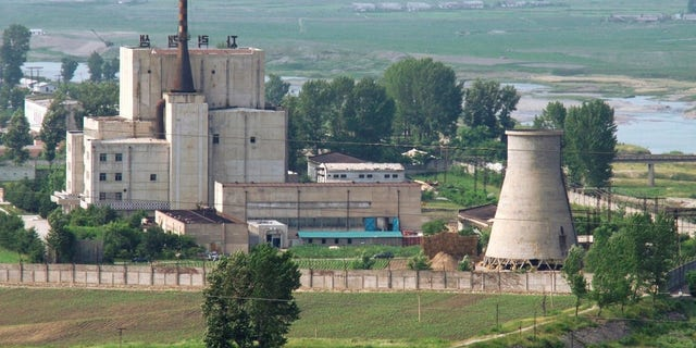 A North Korean nuclear plant is seen before demolishing a cooling tower (R) in Yongbyon.