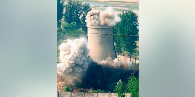 A cooling tower is demolished at a North Korean nuclear plant in Yongbyon in 2007.