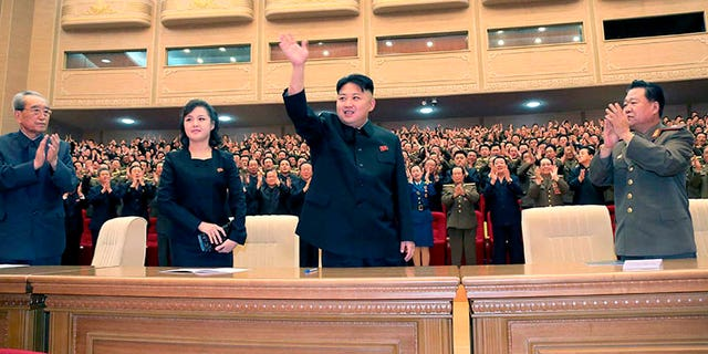 North Korean leader Kim Jong-un waves upon his arrival with his wife Ri Sol-ju for a performance given by the Song and Dance Ensemble of the Korean People's Internal Security Forces (KPISF)  in Pyongyang, in this picture released by North Korea's KCNA news agency May 13, 2013. REUTERS/KCNA (NORTH KOREA - Tags: POLITICS) ATTENTION EDITORS - THIS PICTURE WAS PROVIDED BY A THIRD PARTY. REUTERS IS UNABLE TO INDEPENDENTLY VERIFY THE AUTHENTICITY, CONTENT, LOCATION OR DATE OF THIS IMAGE. NO THIRD PARTY SALES. NOT FOR USE BY REUTERS THIRD PARTY DISTRIBUTORS. THIS PICTURE IS DISTRIBUTED EXACTLY AS RECEIVED BY REUTERS, AS A SERVICE TO CLIENTS - GM1E95D1KE601