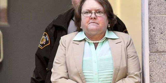 March 10, 2015: Joyce Hardin Garrard walks to the Etowah County Judicial Building from the Etowah County Detention Center in Gadsden, Ala. (AP/AL.com, Frank Couch)