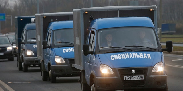 Nov. 2, 2015: Trucks carry the bodies of the victims from a city morgue to the crematorium for identification in St.Petersburg, Russia.
