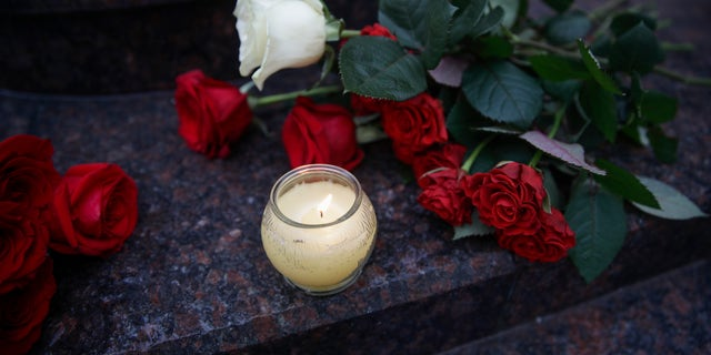Flowers and candles are placed at the choir's building in Moscow, Russia.