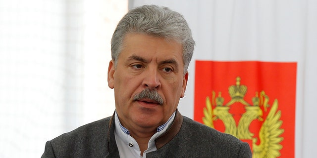 Communist party candidate Pavel Grudinin prepares to cast his ballot in the presidential election at the Lenin state farm outside Moscow, March 18, 2018.