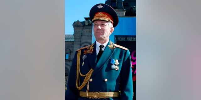 Valery Khalilov, the conductor and head of the Alexandrov choir, stands during the Victory Day military parade in Red Square in 2014.