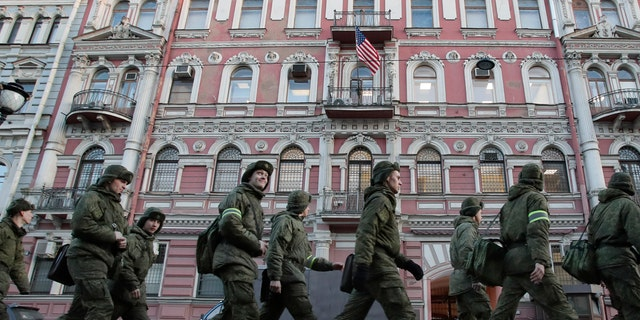 Military cadets walk past the U.S. consulate in St.Petersburg, Russia, March 31, 2018.